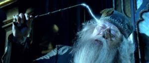 Dumbledore extracts his memories through magic, to store in a pensieve.