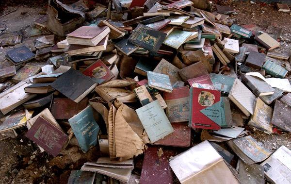 A pile of rejected books. Is this the future of the physical book? Will digital books rise from the ashes?