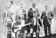 Buddy Bolden in William Cornish's band. Bolden is the cornet player in the top row, second from the left, just above Brock Mumford on guitar.