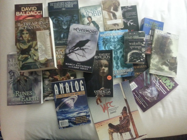 The new books I hauled home somehow after the convention