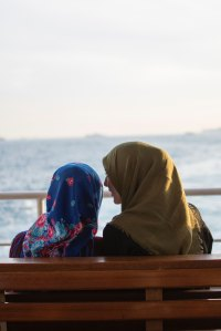 two hijabi women talking