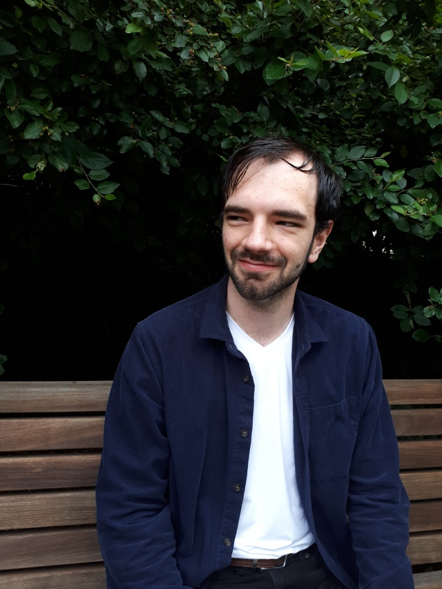 Matthew Rettino sitting on a park bench
