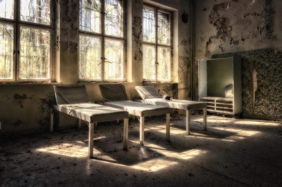 dingy sanatorium beds by a window